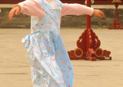 Girl Dancing—Forbidden City, China, 2009