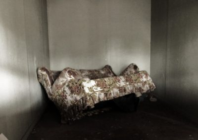 Creepy couch in an abandoned motel—New Mexico, 2011