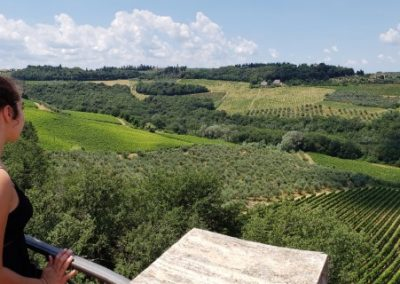 My daughter looking over Tuscan vineyard, 2018